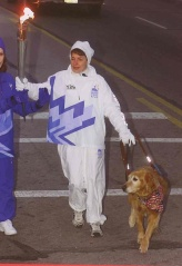 Mary Hiland carries the Olympic Torch with Sherry